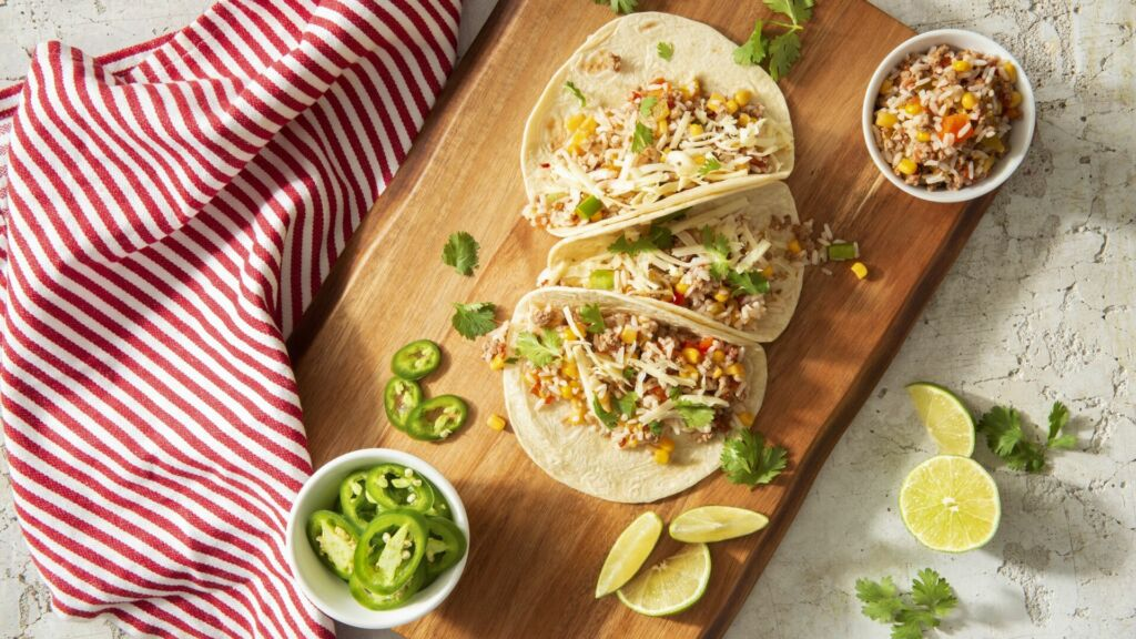 Mexican beef tacos with peppers and lime