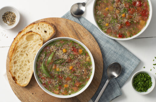 quinoa-soup-with-tomato-and-fresh-herbs-served-with-bread
