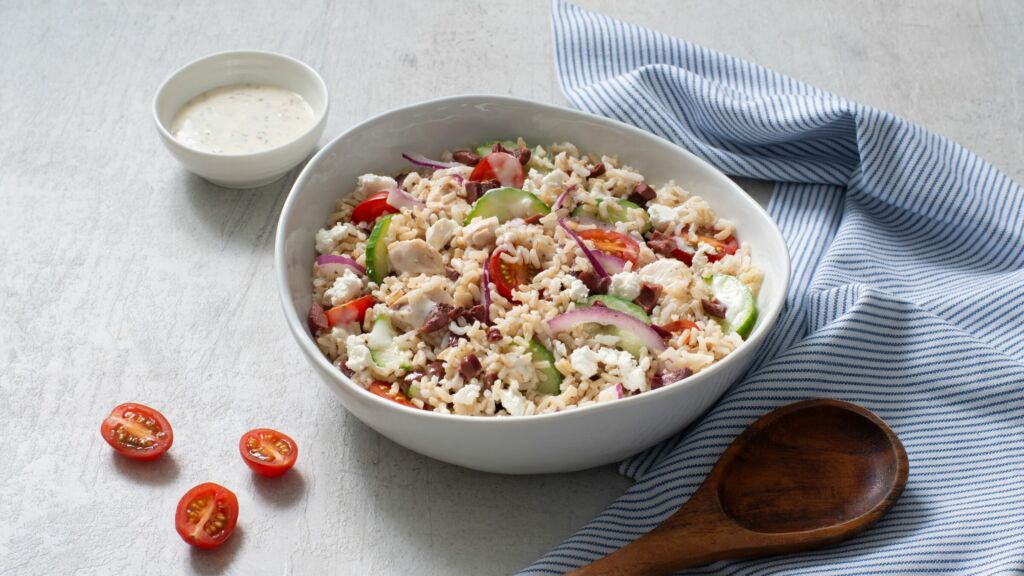 chicken-and-rice-salad-with-caesar-dressing-cherry-tomatoes-olives-red-onion-and-cucumber