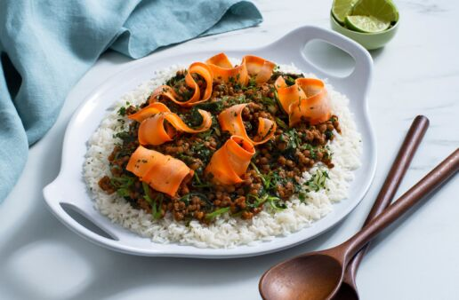 thai-lentil-salad-with-carrots-baby-spinach-and-curry-paste-served-over-jasmine-rice