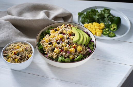 rice-salad-bowl-with-mango-black-beans-rice-corn-bell-peppers-salad-greens-and-avocado