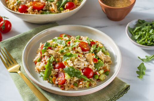 chicken-and-rice-salad-bowl-with-arugula-cherry-tomatoes-celery-and-bottled-vinaigrette-