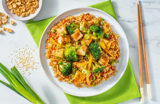 sesame-tofu-stir-fry-with-broccoli-florets-yellow-bell-peppers-green-onion-and-stir-fry-sauce