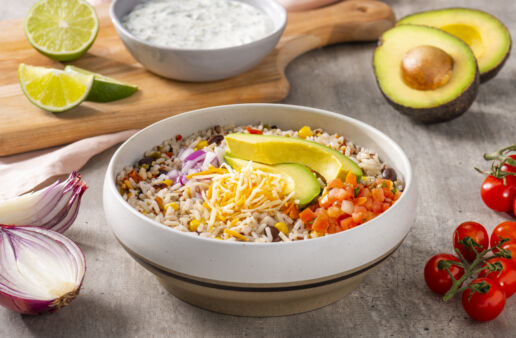 southwest-rice-and-beans-bowl-with-avocado-salsa-shredded-mexican-cheese-blend-red-onion-and-cilantro-lime-cream